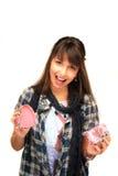 Young girl holding a gift box Stock Photos