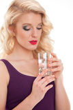 Young girl holding glass of water Stock Images