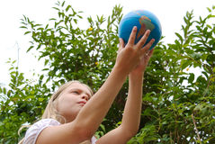 Young girl holding globe in hands Stock Photo