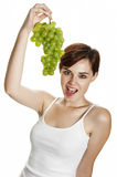 Young girl holding a grape wine Stock Image
