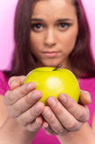 Young girl holding green apple. Stock Images