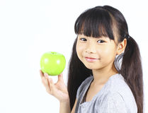 Young girl holding green apple Royalty Free Stock Photo