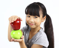 Young girl holding green apple Stock Photos