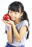 Young girl holding green apple Royalty Free Stock Images