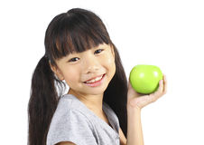 Young girl holding green apple Royalty Free Stock Photos