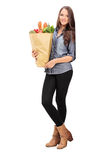 Young girl holding a grocery bag Royalty Free Stock Photo