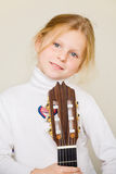 Young girl holding a guitar Stock Photos