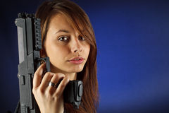 Young girl holding gun Royalty Free Stock Photo