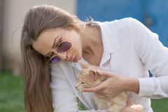 Young girl holding her cute little kitten Royalty Free Stock Image