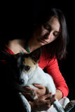 Young girl holding her dog royalty free stock photos