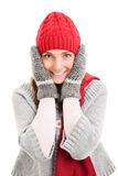 Young girl holding her head wearing winter clothes. Portrait of a beautiful young woman holding her head wearing winter clothes isolated on white background Stock Photography