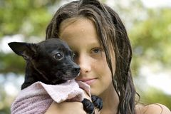 Young girl holding her puppy Royalty Free Stock Photos