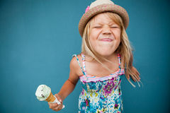 Young girl holding ice cream cone Stock Images