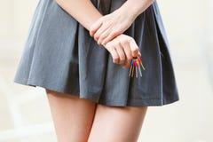 Young girl holding keyring. Royalty Free Stock Image