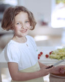 Young girl holding knife in kitchen Royalty Free Stock Photo