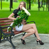Young girl holding a large bouquet of white roses Stock Photography