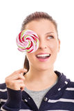 Young girl holding a lollipop Royalty Free Stock Image