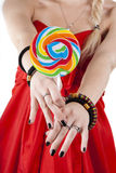 Young girl is holding a lollypop Stock Photo