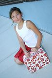 Young girl holding luggage Royalty Free Stock Image