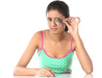 Young girl holding magnifying glass Royalty Free Stock Photography