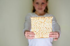 Jewish girl holding matzah for Passover. stock image