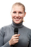Young girl holding microphone Stock Photos