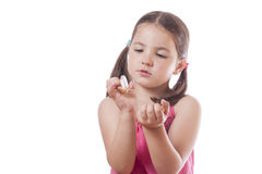Young girl holding an open fortune cookie stock photo
