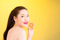 Young girl holding orange slice Royalty Free Stock Photos