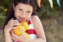 Young girl holding oranges Stock Photos