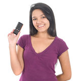 Young girl holding out mobile phone Royalty Free Stock Images