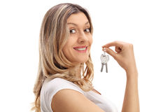 Young girl holding a pair of keys Royalty Free Stock Image