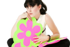 Young Girl Holding Paper Flowers. Beautiful young girl holding purple and green paper flowers. Shot in studio over white Royalty Free Stock Photography