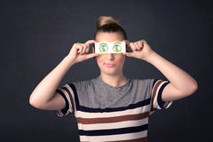 Young girl holding paper with green dollar sign Royalty Free Stock Images