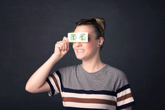 Young girl holding paper with green dollar sign Royalty Free Stock Photos