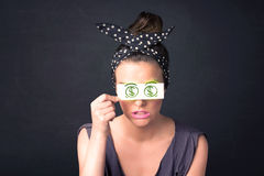 Young girl holding paper with green dollar sign Stock Photos