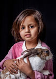Young girl holding pet rabbit Stock Photography