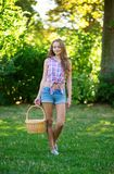 Young girl holding a picnic basket Royalty Free Stock Photos