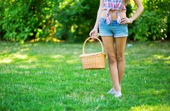 Young girl holding a picnic basket Stock Photography
