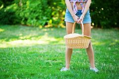 Young girl holding picnic basket Stock Images