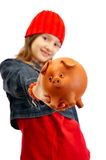 Young girl holding piggy bank Royalty Free Stock Photo