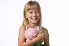 Young girl holding a piggy bank Royalty Free Stock Photos