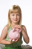 Young girl holding a piggy bank Stock Photos