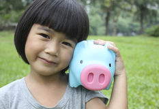 Young girl holding piggy bank Stock Image