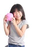 Young girl holding piggy bank Royalty Free Stock Photos
