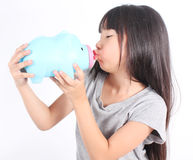 Young girl holding piggy bank Stock Images