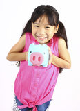 Young girl holding piggy bank Royalty Free Stock Photos