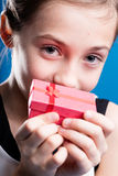 Young girl holding pink box Royalty Free Stock Photo