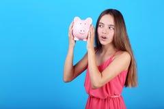 Girl holding pink piggybank royalty free stock photo