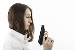 Young girl holding a pistol Royalty Free Stock Photo
