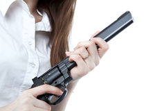 Young girl holding a pistol Stock Image